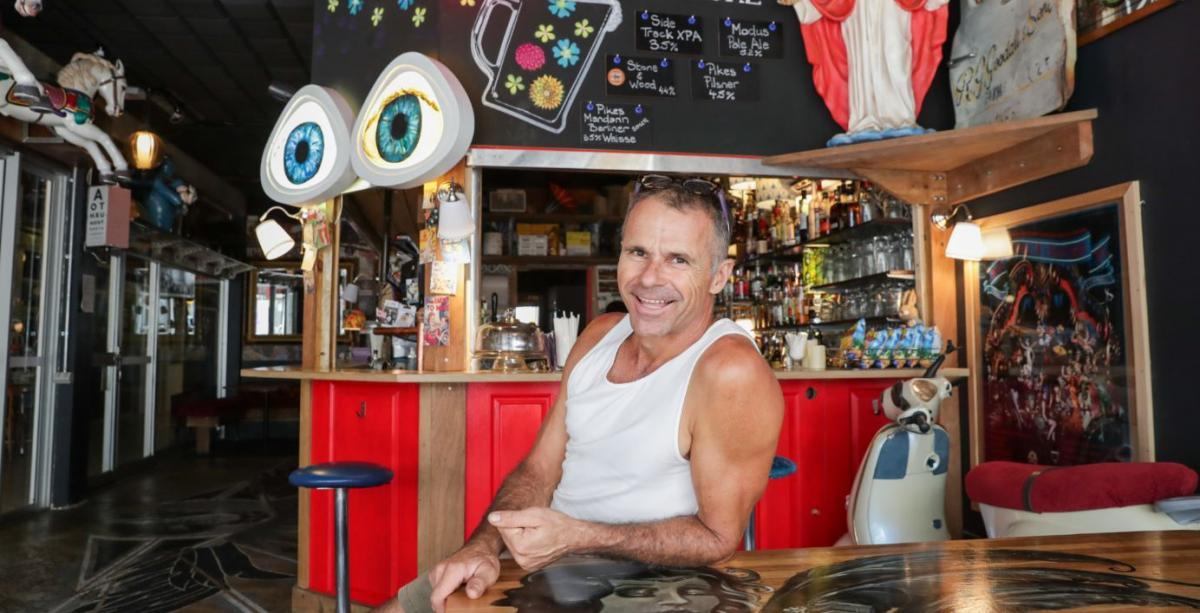 Man sitting in front of bar